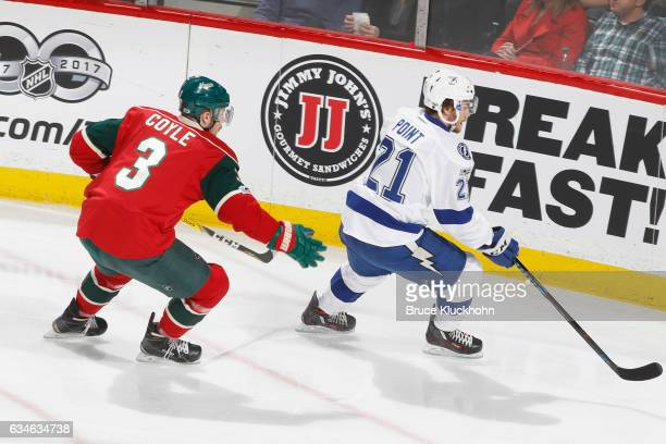 Brayden Point of the Tampa Bay Lightning skates to the puck with Charlie Coyle of the Minnesota Wild defending during the game on February 10 2017 at...