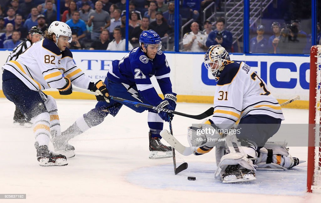 Brayden Point #21 of the Tampa Bay Lightning takes a shot on Chad Johnson #31 of the Buffalo Sabres during a game at Amalie Arena on February 28, 2018 in Tampa, Florida.
