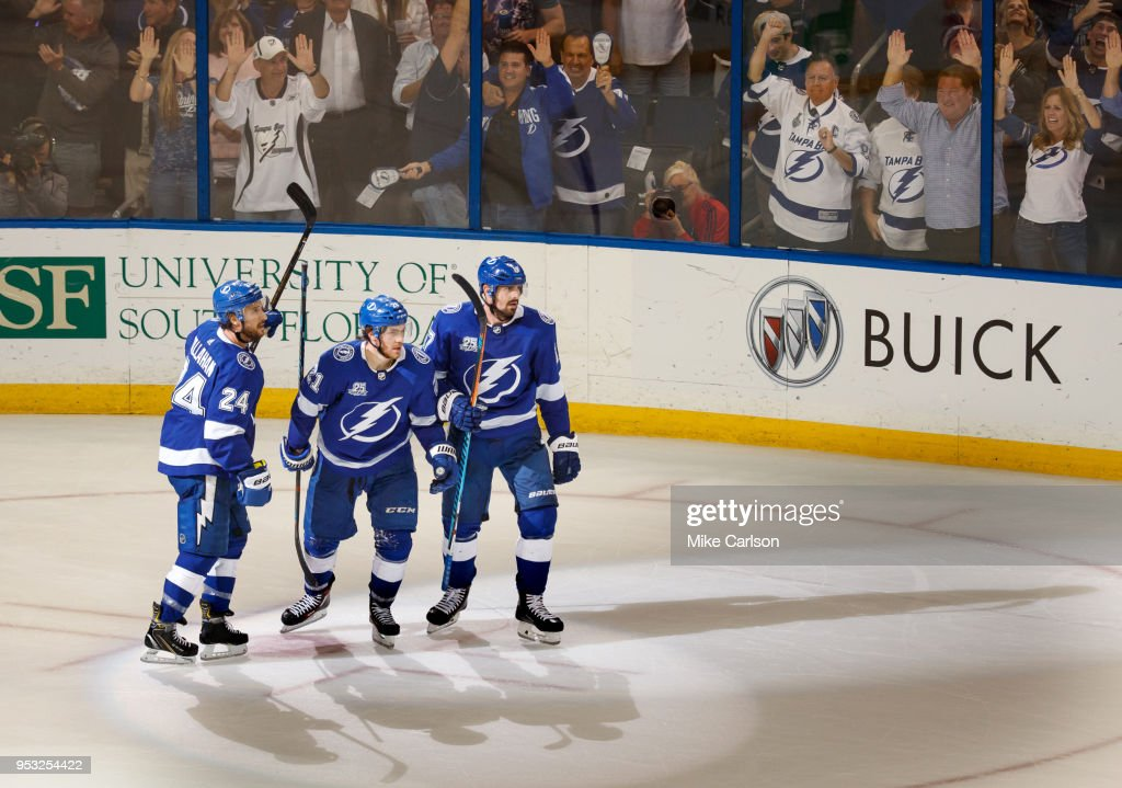 Brayden Point #21, Ryan Callahan #24, and Alex Killorn #17 of the Tampa Bay Lightning celebrate a goal against the Boston Bruins during Game Two of the Eastern Conference Second Round during the 2018 NHL Stanley Cup Playoffs at Amalie Arena on April 30, 2018 in Tampa, Florida.