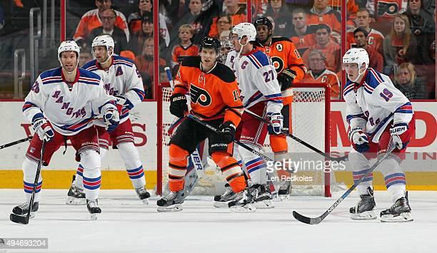 Brayden Schenn and Wayne Simmonds of the Philadelphia Flyers set up a scoring attempt against Dominic Moore Dan Girardi Henrik Lundqvist Ryan...