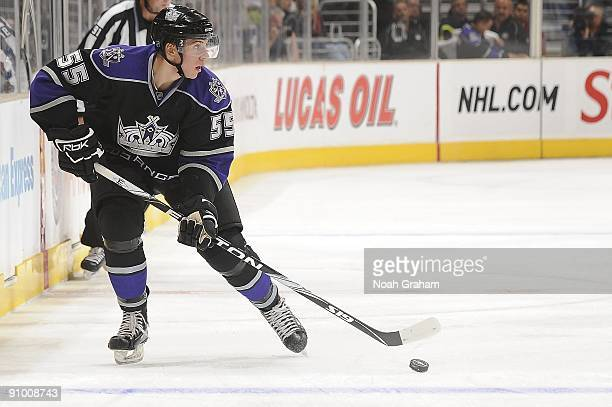 Brayden Schenn of the Los Angeles Kings handles the puck alongside the boards against the Anaheim Ducks during the NHL preseason game on September 19...