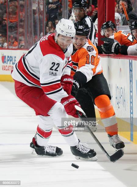 Brayden Schenn of the Philadelphia Flyers battles for the loose puck with Brett Pesce of the Carolina Hurricanes on April 9 2017 at the Wells Fargo...