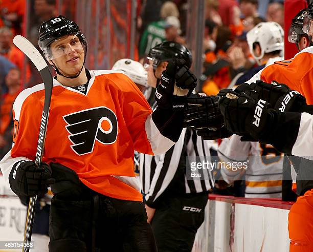 Brayden Schenn of the Philadelphia Flyers celebrates his goal with teammates on the bench in the third period against the Buffalo Sabres at Wells...