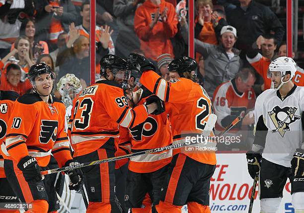 Brayden Schenn of the Philadelphia Flyers celebrates his second period powerplay goal against the Pittsburgh Penguins with teammates Jakub Voracek...