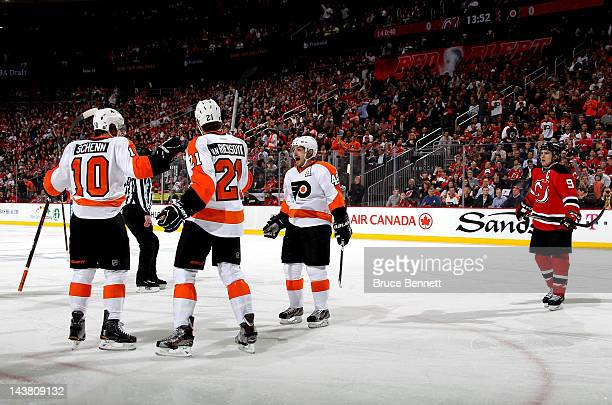Brayden Schenn of the Philadelphia Flyers celebrates with teammates James van Riemsdyk and Danny Briere after scoring a goal against Martin Brodeur...
