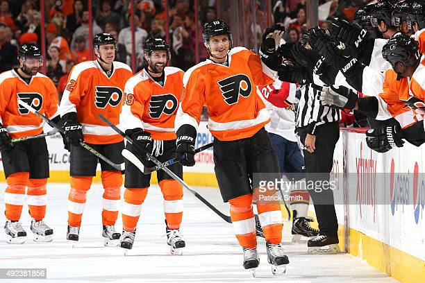 Brayden Schenn of the Philadelphia Flyers celebrates with teammates on the bench after scoring a first period goal against the Florida Panthers at...