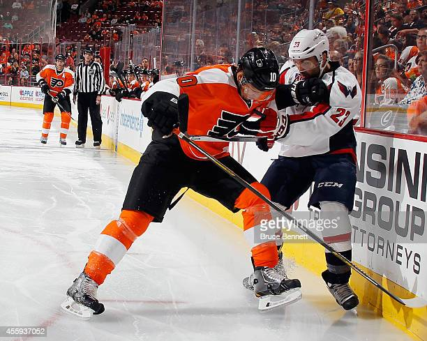 Brayden Schenn of the Philadelphia Flyers checks Chris Conner of the Washington Capitals into the boards during the first period at Wells Fargo...