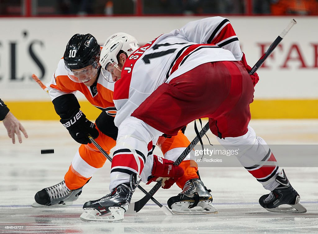 Brayden Schenn #10 of the Philadelphia Flyers faces off against Jordan Staal #11 of the Carolina Hurricanes on April 13, 2014 at the Wells Fargo Center in Philadelphia, Pennsylvania. The Hurricanes went on to defeat the Flyers 6-5 in a shootout.