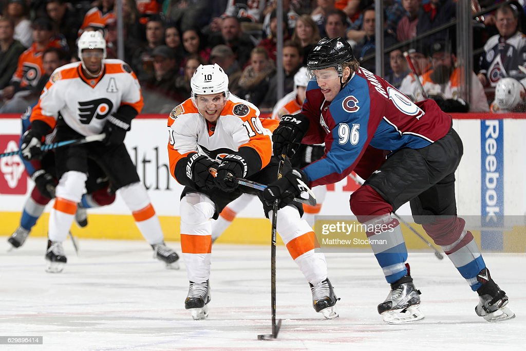 Brayden Schenn #10 of the Philadelphia Flyers fights for control of the puck against Mikko Rantanen #96 of the Colorado Avalanche at the Pepsi Center on December 14, 2016 in Denver, Colorado.