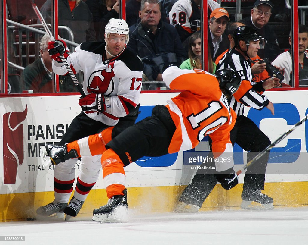 Brayden Schenn #10 of the Philadelphia Flyers is checked to the ice by Ilya Kovalchuk #17 of the New Jersey Devils on March 15, 2013 at the Wells Fargo Center in Philadelphia, Pennsylvania.