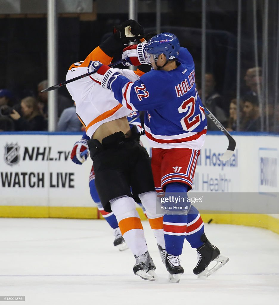 Philadelphia flyers v new york rangers photos and images getty brayden schenn 10 of the philadelphia flyers is hit by nick holden 22 of publicscrutiny Image collections