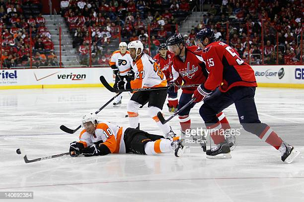 Brayden Schenn of the Philadelphia Flyers passes the puck against the Washington Capitals during the second period at the Verizon Center on March 4...