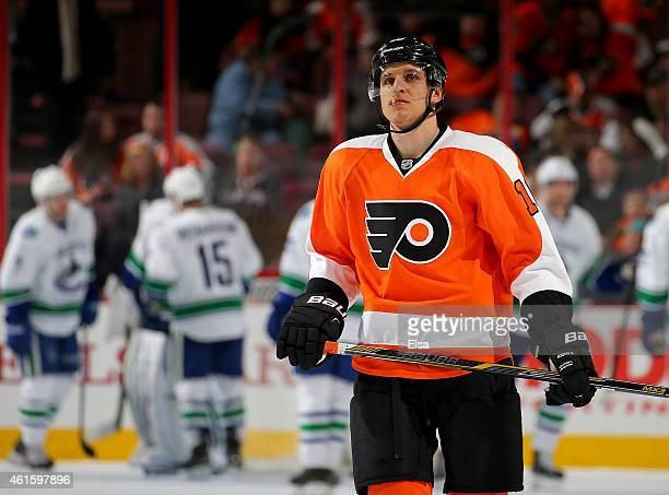 Brayden Schenn of the Philadelphia Flyers reacts to the loss as the Vancouver Canucks celebrate the win on January 15 2015 at the Wells Fargo Center...