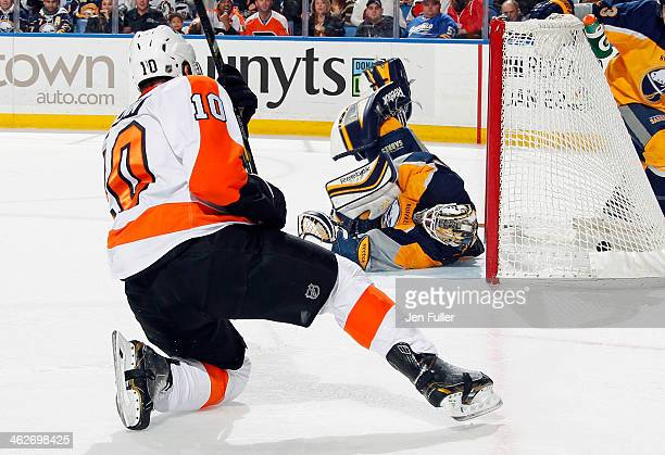 Brayden Schenn of the Philadelphia Flyers scores a thirdperiod goal against Jhonas Enroth of the Buffalo Sabres on January 14 2014 at the First...