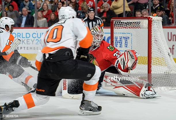 Brayden Schenn of the Philadelphia Flyers scores on goalie Scott Darling of the Chicago Blackhawks in the second period of the NHL game at the United...