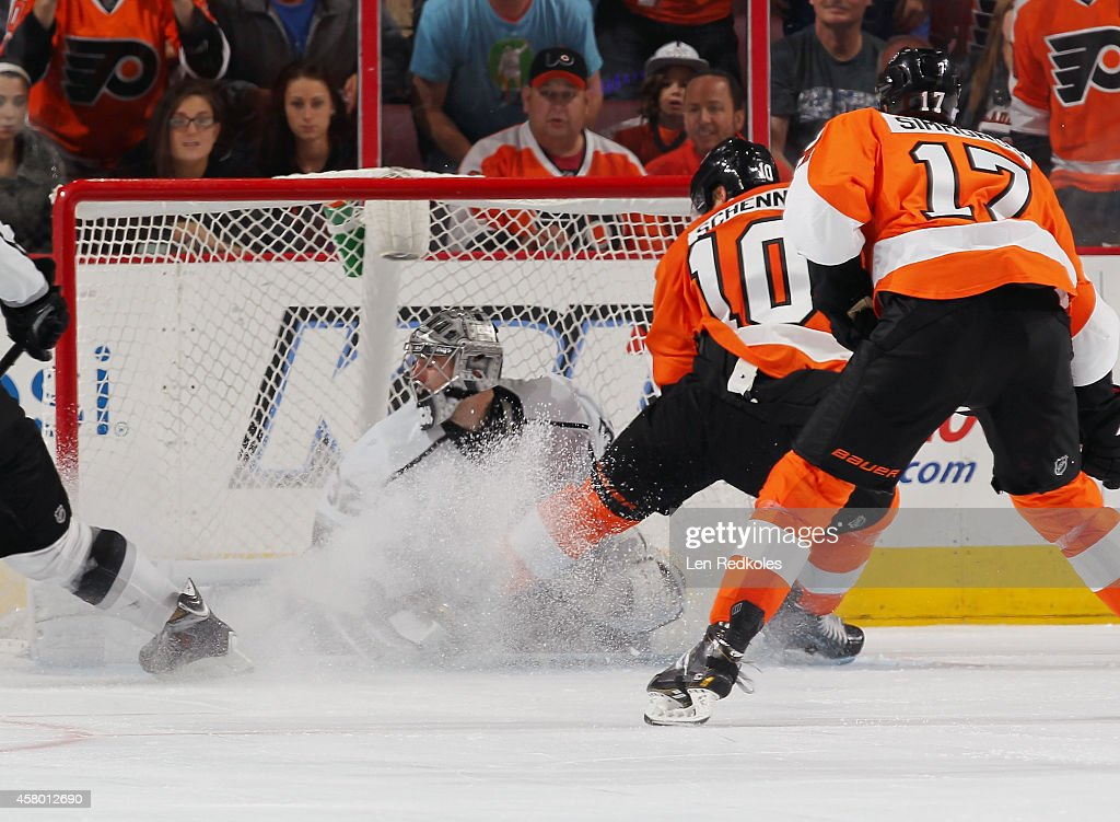 Brayden Schenn #10 of the Philadelphia Flyers scores the game-winning overtime goal against Jonathan Quick #32 of the Los Angeles Kings on October 28, 2014 at the Wells Fargo Center in Philadelphia, Pennsylvania. The Flyers defeated the Kings 3-2 in overtime.