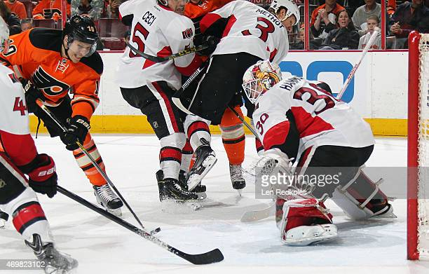 Brayden Schenn of the Philadelphia Flyers takes a shot on goal against Andrew Hammond of the Ottawa Senators on April 11 2015 at the Wells Fargo...