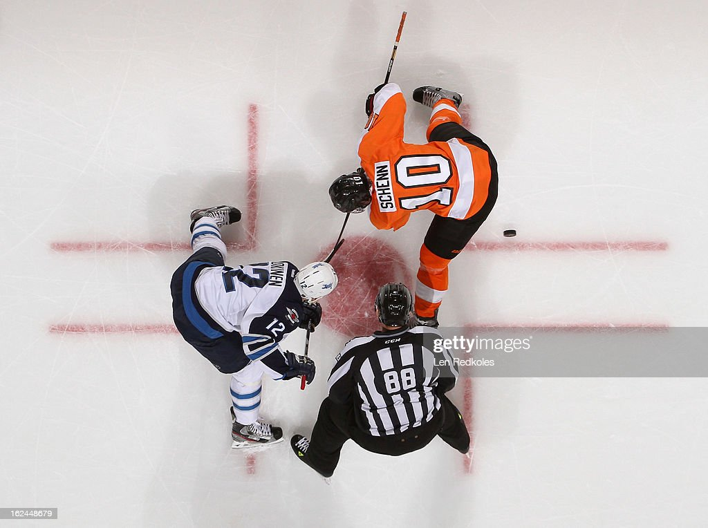 Brayden Schenn #10 of the Philadelphia Flyers wins a face off against Olli Jokinen #12 of the Winnipeg Jets on February 23, 2013 at the Wells Fargo Center in Philadelphia, Pennsylvania. The Flyers went on to defeat the Jets 5-3.