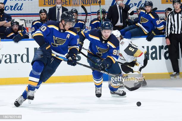 Brayden Schenn of the St. Louis Blues and Vladimir Tarasenko of the St. Louis Blues look for control of the puck on March 12, 2021 at the Enterprise...