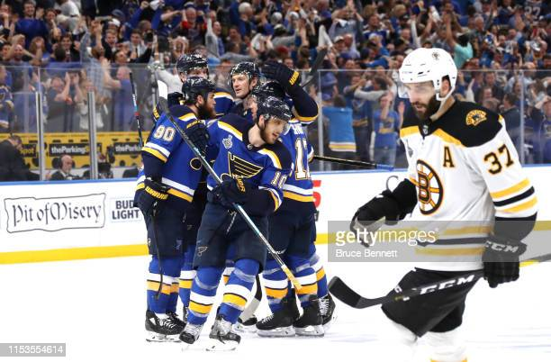 Brayden Schenn of the St Louis Blues celebrates his emptynet goal in the third period at 1831 as Patrice Bergeron of the Boston Bruins looks on in...