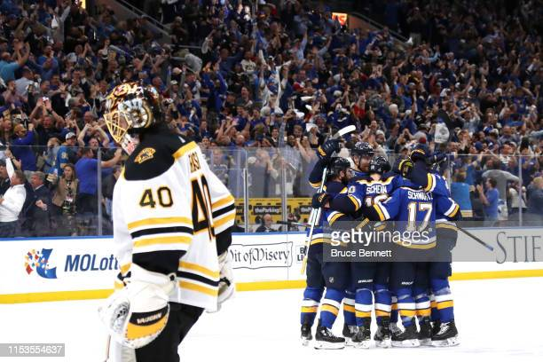 Brayden Schenn of the St. Louis Blues celebrates his empty-net goal in the third period at 18:31 as Tuukka Rask of the Boston Bruins looks on in Game...