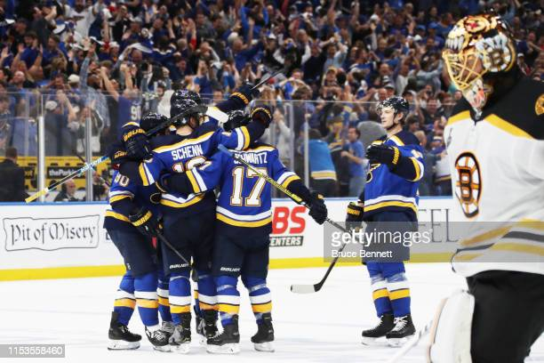 Brayden Schenn of the St Louis Blues celebrates his emptynet goal in the third period at 1831 as Tuukka Rask of the Boston Bruins looks on in Game...
