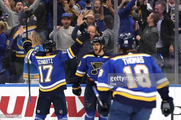 Brayden Schenn of the St. Louis Blues celebrates with Jaden Schwartz and Robert Thomas after scoring a goal on Martin Jones of the San Jose Sharks...