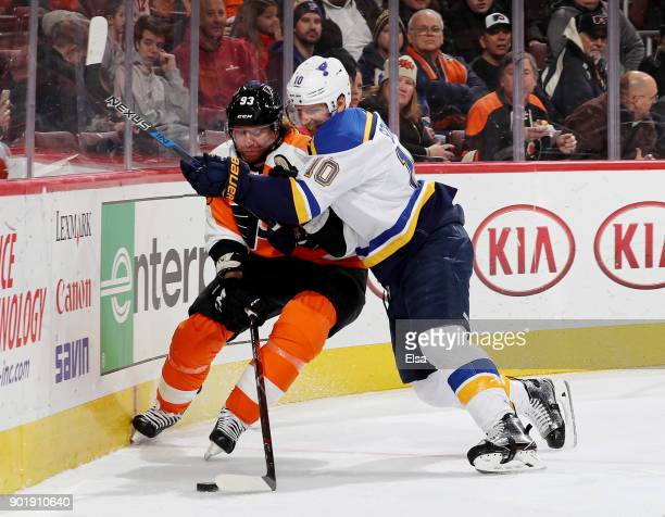 Brayden Schenn of the St Louis Blues checks Jakub Voracek of the Philadelphia Flyers in the second period on January 6 2018 at Wells Fargo Center in...