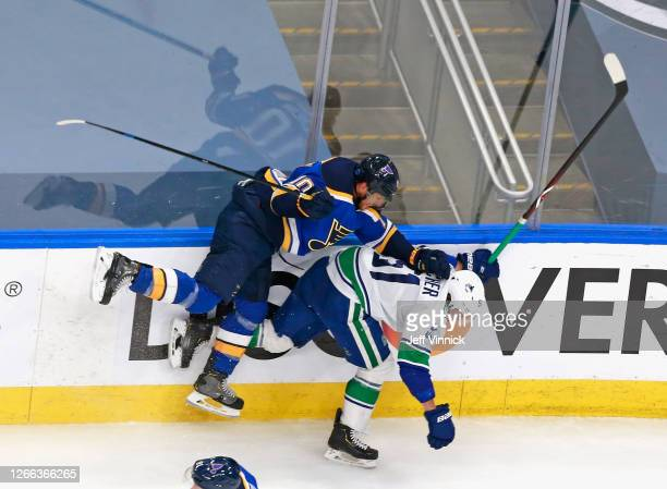 Brayden Schenn of the St. Louis Blues checks Troy Stecher of the Vancouver Canucks during the third period in Game Two of the Western Conference...