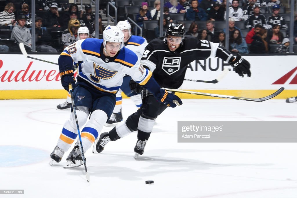 Brayden Schenn #10 of the St. Louis Blues handles the puck against Alex Iafallo #19 of the Los Angeles Kings at STAPLES Center on March 10, 2018 in Los Angeles, California.