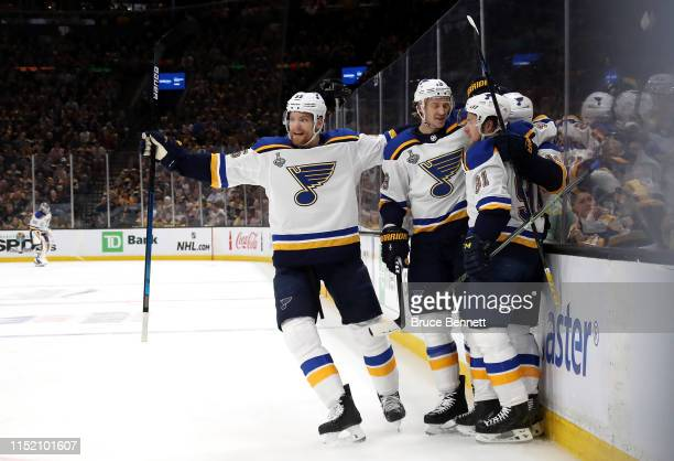 Brayden Schenn of the St Louis Blues is congratulated by his teammates after scoring a first period goal against the Boston Bruins in Game One of the...