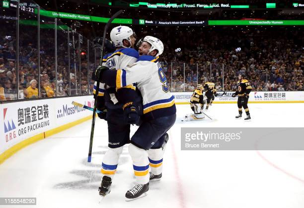 Brayden Schenn of the St. Louis Blues is congratulated by his teammate Vladimir Tarasenko after scoring a third period goal against the Boston Bruins...