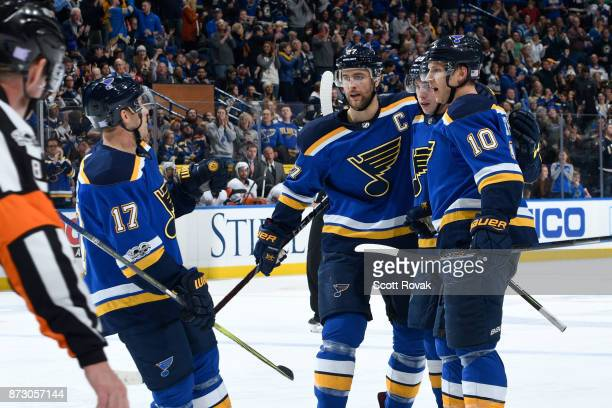 Brayden Schenn of the St Louis Blues is congratulated by teammates after scoring a goal against the New York Islanders at Scottrade Center on...