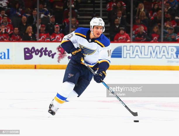 Brayden Schenn of the St Louis Blues plays the puck during the game against the New Jersey Devils at Prudential Center on November 7 2017 in Newark...