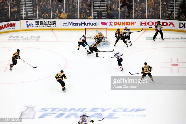 Brayden Schenn of the St Louis Blues scores a first period goal past Tuukka Rask of the Boston Bruins in Game One of the 2019 NHL Stanley Cup Final...