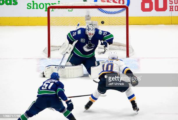 Brayden Schenn of the St. Louis Blues scores the game winning goal at 15:06 of overtime against Jacob Markstrom of the Vancouver Canucks in Game Four...