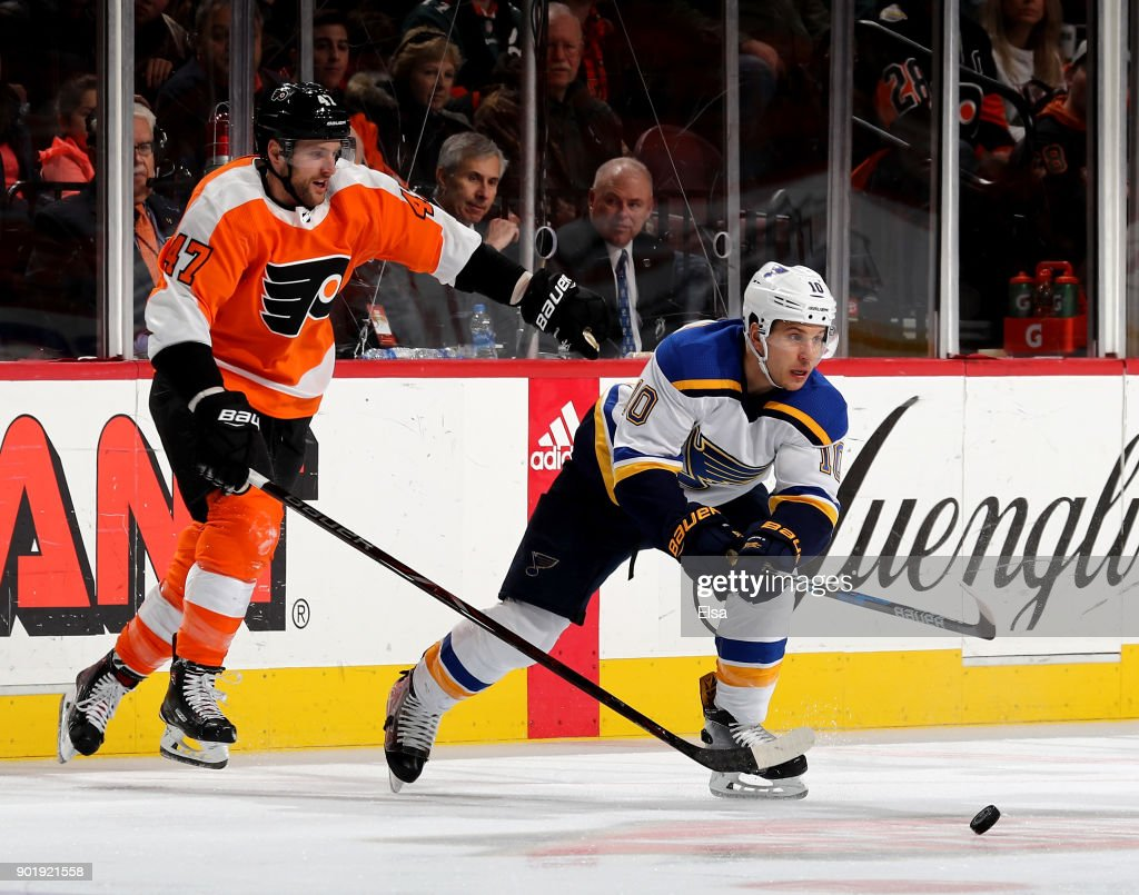 Brayden Schenn #10 of the St. Louis Blues takes the puck as Andrew MacDonald #47 of the Philadelphia Flyers defends on January 6, 2018 at Wells Fargo Center in Philadelphia, Pennsylvania.