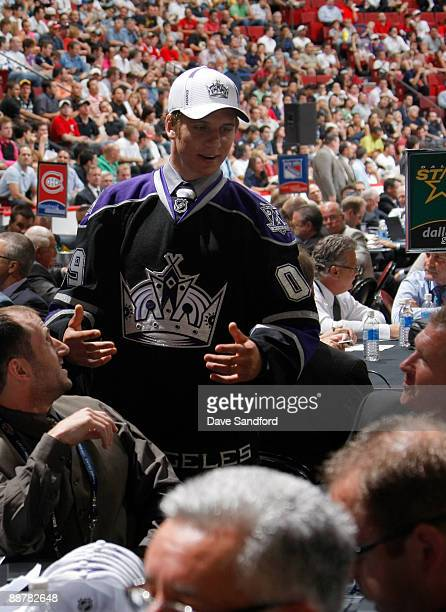 Brayden Schenn speaks to Los Angeles Kings scouts Michael Futa and Mark Yanetti after being selected fifth overall by the Los Angeles Kings during...