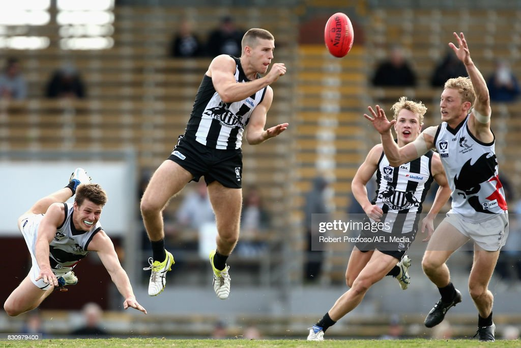 Brayden Sier of Collingwood handballs during the round 16 VFL match between the Collingwood Magpies and North Ballarat at Victoria Park on August 13, 2017 in Melbourne, Australia.