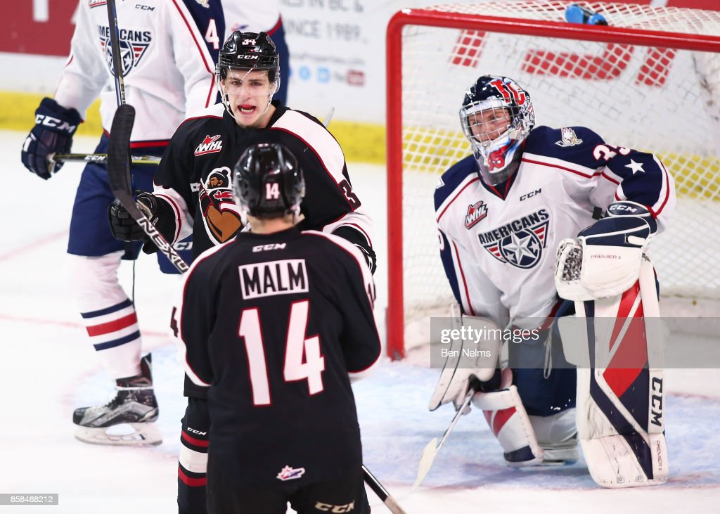 Brayden Watts #34 of the Vancouver Giants celebrates his goal against goaltender Beck Warm #35 of the Tri-City Americans with teammate James Malm #14 during the first period of their WHL game at the Langley Events Centre on October 6, 2017 in Langley, British Columbia, Canada.