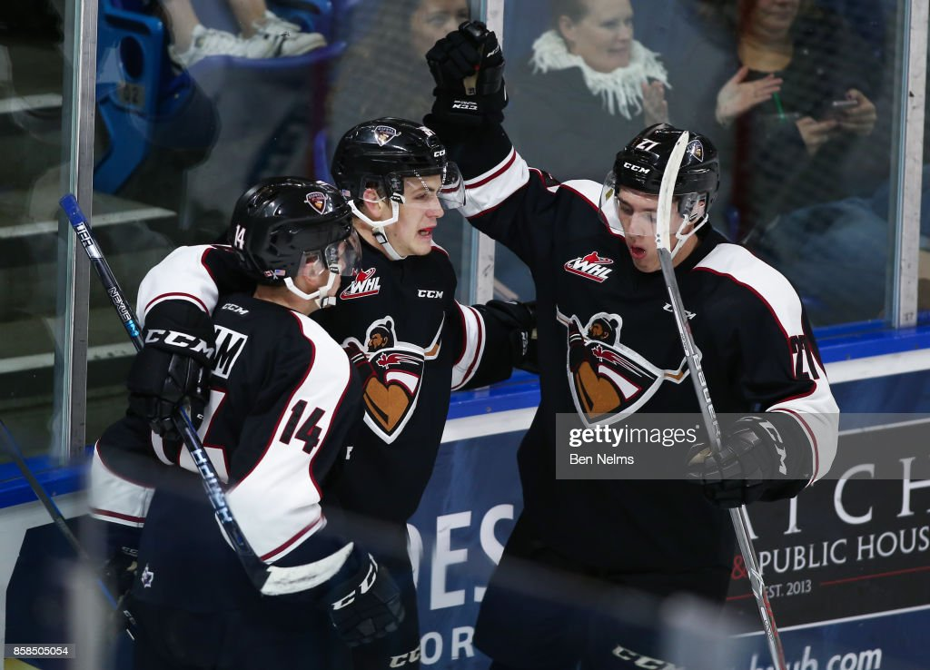 Brayden Watts #34 of the Vancouver Giants celebrates his goal against the Tri-City Americans with teammates James Malm #14 and Brendan Semchuk #27 during the second period of their WHL game at the Langley Events Centre on October 6, 2017 in Langley, British Columbia, Canada.