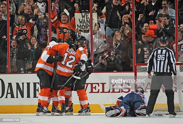 Braydon Coburn Michael Raffl and Jakub Voracek of the Philadelphia Flyers celebrate Voracek's gametying goal in the third period against Kevin Poulin...