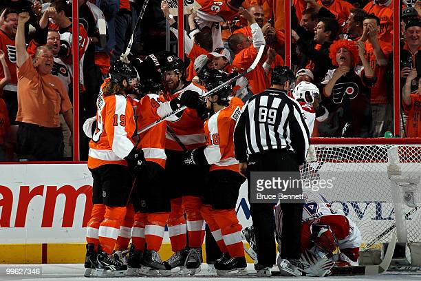 Braydon Coburn of the Philadelphia Flyers celebrates after his goal with teammates Danny Briere, Scott Hartnell and Kimmo Timonen in the first period...