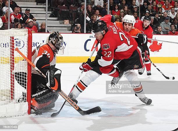 Braydon Coburn of the Philadelphia Flyers checks Chris Kelly of the Ottawa Senators off his feet in the crease of Antero Niittymaki of the...