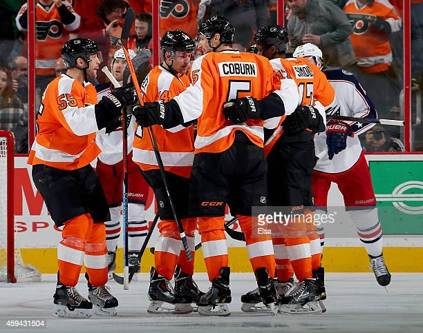 Braydon Coburn of the Philadelphia Flyers is congratulated by teammates Nick SchultzSean Couturier and Wayne Simmonds after Corburn scored a goal in...