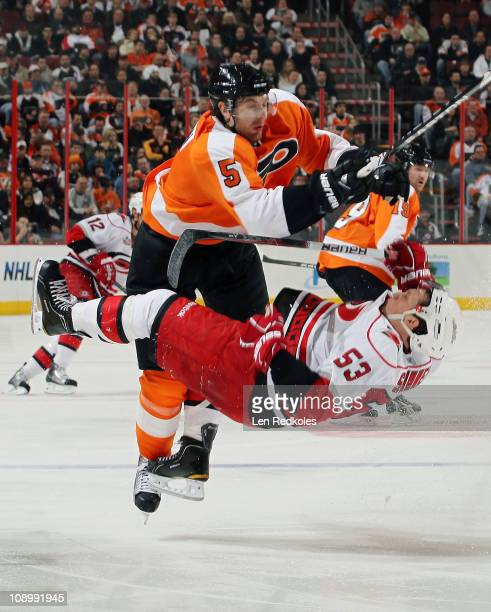 Braydon Coburn of the Philadelphia Flyers openice checks Jeff Skinner of the Carolina Hurricanes on February 10 2011 at the Wells Fargo Center in...