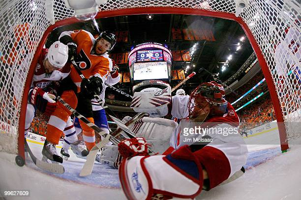Braydon Coburn of the Philadelphia Flyers scores a goal in the first period against Brian Gionta and Jaroslav Halak of the Montreal Canadiens in Game...