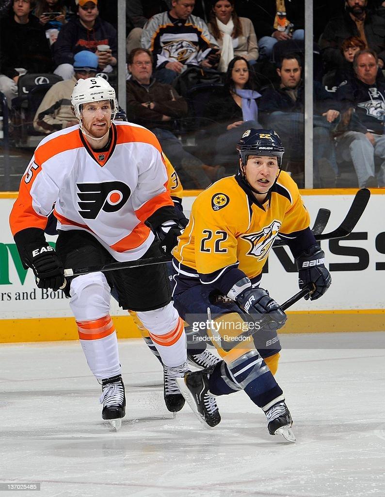 Braydon Coburn #5 of the Philadelphia Flyers skates against Jordin Tootoo #22 of the Nashville Predators at Bridgestone Arena on January 14, 2012 in Nashville, Tennessee.