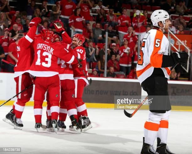 Braydon Coburn of the Philadelphia Flyers skates to the bench as Jonathan Ericsson Niklas Kronwall Pavel Datsyuk and Henrik Zetterberg of the Detroit...