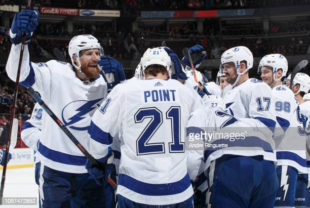 Braydon Coburn of the Tampa Bay Lightning celebrates a win over the Ottawa Senators with teammates including Brayden Point and Alex Killorn at...
